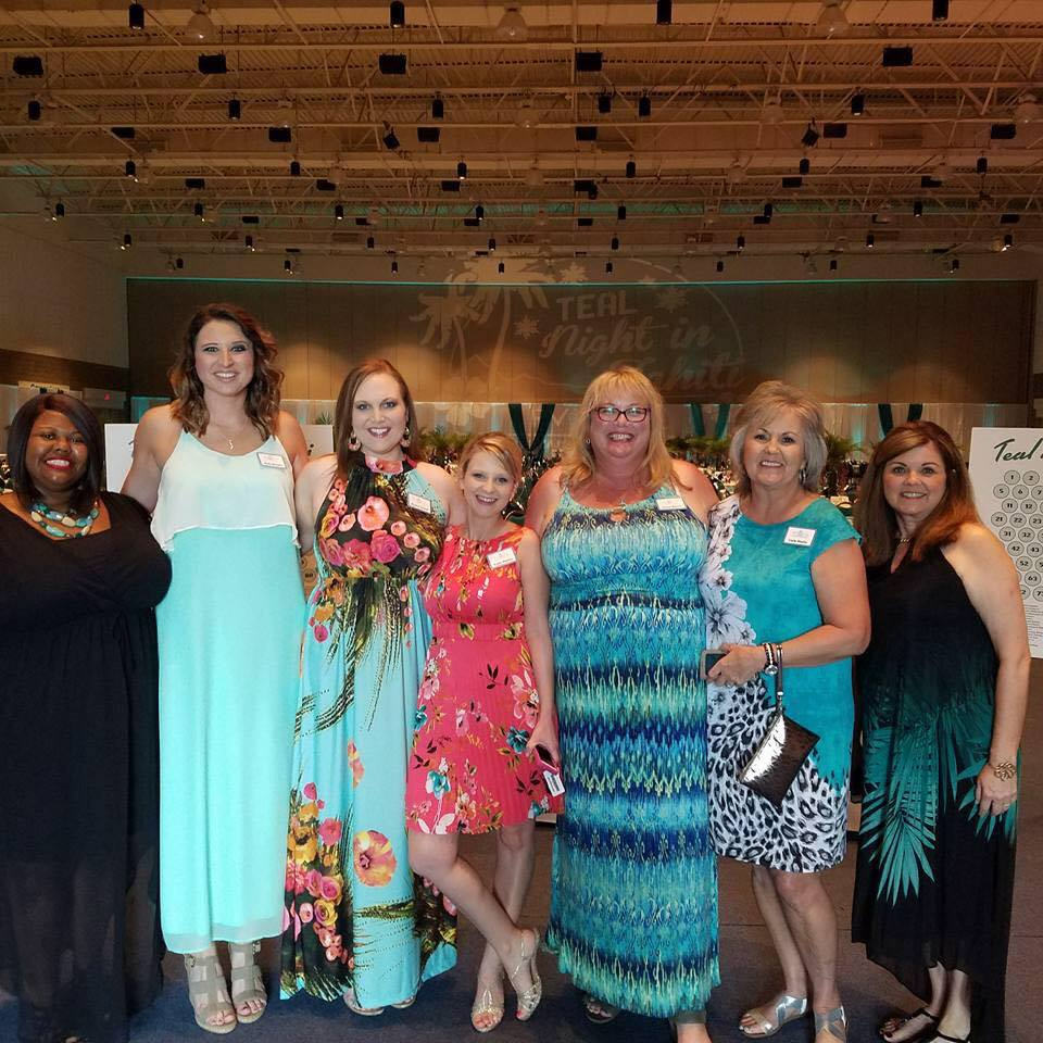 RVOCA Volunteers Teal Night in Tahiti Fundraiser Event Fort Smith Arkansas Convention Center